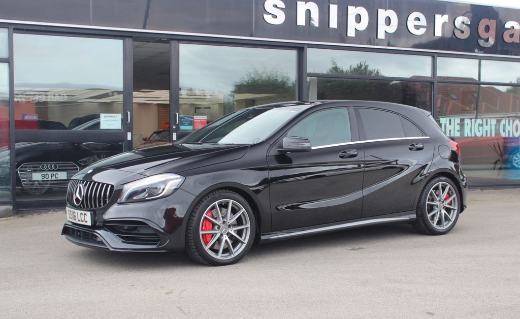 USED 2016 16 MERCEDES-BENZ A-CLASS 2.0 AMG A 45 4MATIC PREMIUM 5d 375 BHP Facelift Cosmos Black Metallic A45 Premium, Panoramic Sliding Glass Sunroof, Rear View Camera, Heated Seats, Harman Kardon Music System, Active Park Assist, Electric Seats With Memory, Satellite Navigation, Auto Dim Mirrors, Memory Package, AMG Performance Steering Wheel, Ran Sensor, Compartment Package, Cruise Control, Red Brake Callipers, Tyre Pressure Control, Electric Folding Mirrors, DAB Radio, AMG Performance Seats, AMG Styling Package, Ambiance Illumination, Keyless Go, Illuminated Door S