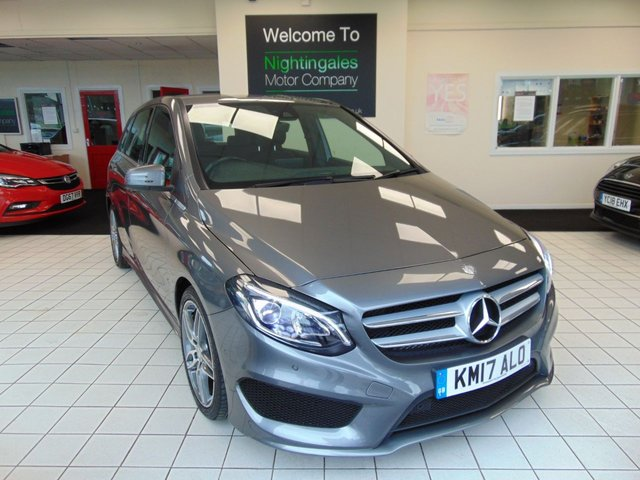 """USED 2017 17 MERCEDES-BENZ B-CLASS 2.1 B 200 D AMG LINE PREMIUM 5d 134 BHP SERVICE HISTORY + MAY 2021 MOT + SATELLITE NAVIGATION + BLUETOOTH + CRUISE CONTROL + CLIMATE CONTROL + HALF LEATHER TRIM + HEATED FRONT SEATS + FRONT AND REAR PARKING SENSORS + ABS + REMOTE CENTRAL LOCKING + ELECTRIC WINDOWS + ONLY £20 ROAD TAX + 8"""" MEDIA DISPLAY + DRIVER ALERT SYSTEM + LED DAYTIME RUNNING LIGHTS + ISOFIX OUTER SEATS + HALOGEN HEADLIGHTS + FRONT DOOR SILLS ILLUMINATED + 18"""" AMG ALLOYS + DRIVERS SEAT HEIGHT ADJUSTMENT"""