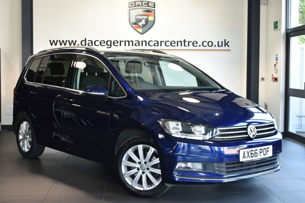 """USED 2017 66 VOLKSWAGEN TOURAN 1.4 SEL TSI BLUEMOTION TECHNOLOGY DSG 5DR 7SEATS AUTO 148 BHP Finished in a stunning metallic blue styled with 17"""" alloys. Upon opening the drivers door you are presented with cloth upholstery, full service history, satellite navigation, bluetooth, cruise control, dab radio,  multi functional steering wheel, 7 seats, heated mirrors, climate control, parking sensors"""