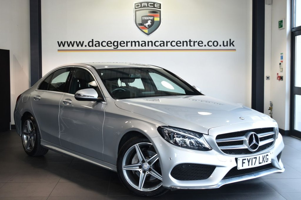 "USED 2017 17 MERCEDES-BENZ C-CLASS 2.1 C 220 D AMG LINE 4DR AUTO 170 BHP Finished in a stunning iridium metallic silver styled with 18"" alloys. Upon opening the drivers door you are presented with full leather interior, full service history, satellite navigation, bluetooth, heated sport seats, cruise control, dab radio, reversing camera, rain sensors, touchpad with rotary pushbutton, electric folding mirror, ambient lighting, AMG styling package, parking package, mirror package, active park assist"