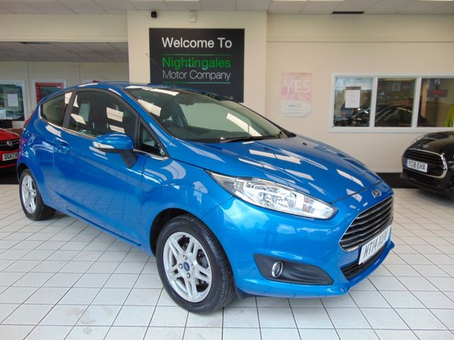 USED 2014 14 FORD FIESTA 1.0 ZETEC 3d 99 BHP SERVICE HISTORY + LONG MOT + AIR CONDITIONING + £0 ROAD TAX + DRIVERS SEAT HEIGHT ADJUSTMENT + ELECTRIC WINDOWS + REMOTE CENTRAL LOCKING + ALLOY WHEELS + RADIO/CD PLAYER COMPATIBLE WITH MP3 + FRONT FOG LIGHTS + QUICK CLEAR HEADLIGHTS + REMOTE AUDIO CONTROLS + 60/40 REAR SEAT SPLIT + ELECTRIC POWER STEERING + ABS + HILL START ASSIST + AUTO STOP START SYSTEM + IMMOBILIZER + AIRBAGS FRONT SIDE AND CURTAIN + CITY PACK + GREAT MPG