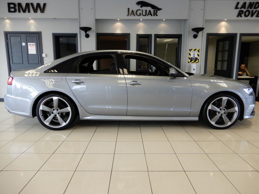 """USED 2015 15 AUDI A6 2.0 TDI ULTRA BLACK EDITION 4d AUTO 188 BHP FINISHED IN STUNNING TORNADO GREY WITH CONTRASTING BLACK SLINE EMBOSSED LEATHER HEATED SEATS + SATELLITE NAVIGATION + DAB DIGITAL RADIO + BLUETOOTH MEDIA + IN CAR ENTERTAINMENT AUX/USB/SD + IMMACULATE LOW MILEAGE A6 WITH ALL THE EXTRAS + SPOTLESS THROUGHOUT + VOICE COMMAND + POWER FOLDING MIRRORS + REAR CLIMATE CONTROL + DUAL ZONE AIR CONDITIONING + AUTOMATIC ADAPTIVE HEADLIGHTS WITH LED DAYTIME RUNNING LIGHTS + GLOSS BLACK INTERIOR TRIM + ADAPTIVE CRUISE CONTROL + AUTOMATIC WIPERS + 20"""" ROTAR A"""