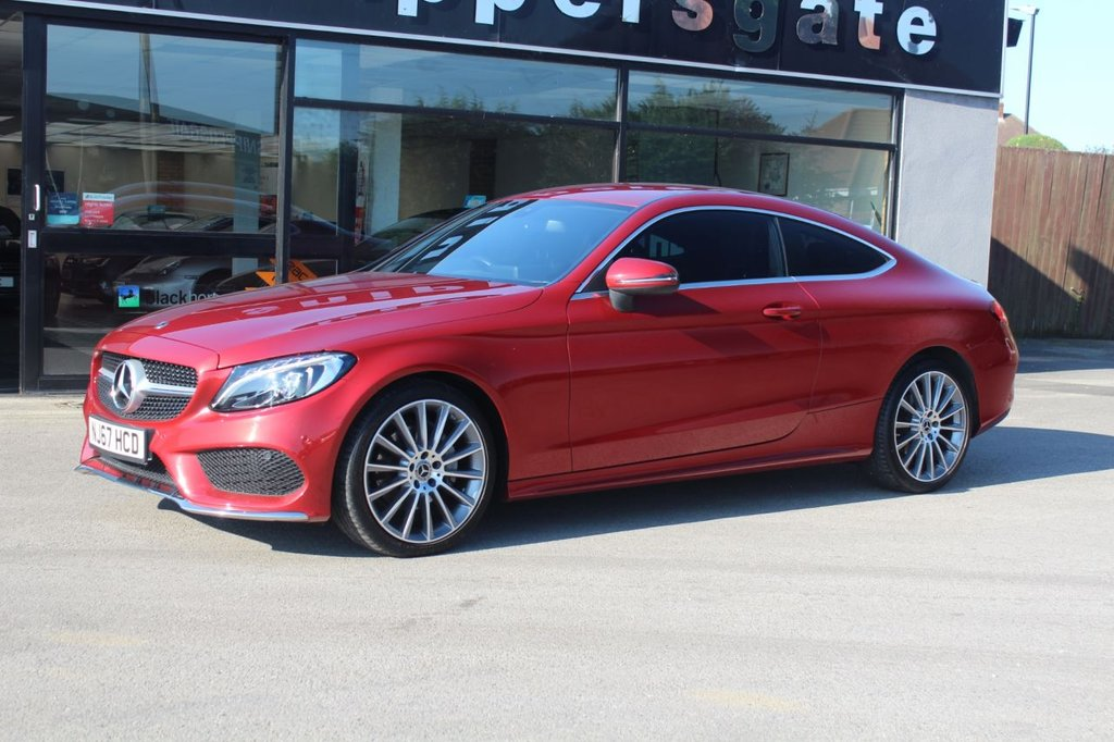 "USED 2017 67 MERCEDES-BENZ C-CLASS 2.1 C 220 D AMG LINE 2d 168 BHP Hyacinth Red Metallic AMG Line, 19"" AMG Multi Spoke Alloys, Heated Seats,Rear View Camera, Privacy Glass, Active park Assist, Auto Dimming Interior and Exterior mirrors, 9 Speed Automatic, Cruise Control, Tire Pressure Control, Electric Folding Mirrors, Ambient Illumination, Bluetooth Phone, Aluminium Trim Pieces, Rain Sensor, Satellite Navigation, AMG Floor Mats, Compartment Package, Keys and Book Pack, Full Mercedes-Benz Service History."