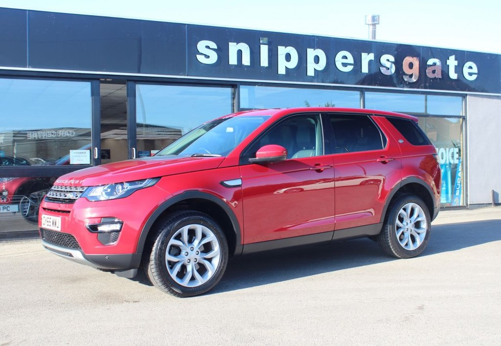 USED 2015 65 LAND ROVER DISCOVERY SPORT 2.0 TD4 HSE 5d 180 BHP Firenze Red Metallic, 7 Seat Configuration, Auto Dimming rear View Mirror, Panoramic Roof, Heated Steering Wheel, Keyless Entry, Heated Seats, Power Tailgate, Ambient Lighting High Line, Auto Lights, DAB Radio, Enhanced Sound System, Front and Rear Parking Aid, Lane Departure Warning System, Rain Sensor, Bluetooth Connectivity and Audio Streeming, Tyre Pressure Monitoring System,  Auto High Beam Assist, Xenon headlamps, Rear Power Point Plug,  Automatic Headlamp Levelling, Cruise Control, Heated