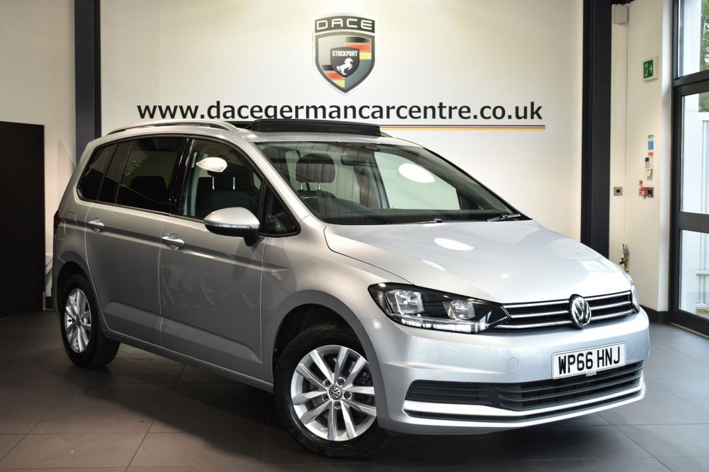 """USED 2017 66 VOLKSWAGEN TOURAN 1.6 SE FAMILY TDI BLUEMOTION TECHNOLOGY DSG 5DR AUTO 114 BHP Finished in a stunning metallic silver styled with 17"""" alloys. Upon opening the drivers door you are presented with cloth upholstery, full service history, satellite navigation, panoramic sliding sunroof, bluetooth, dab radio, multi functional steering wheel, heated mirrors, parking sensors"""