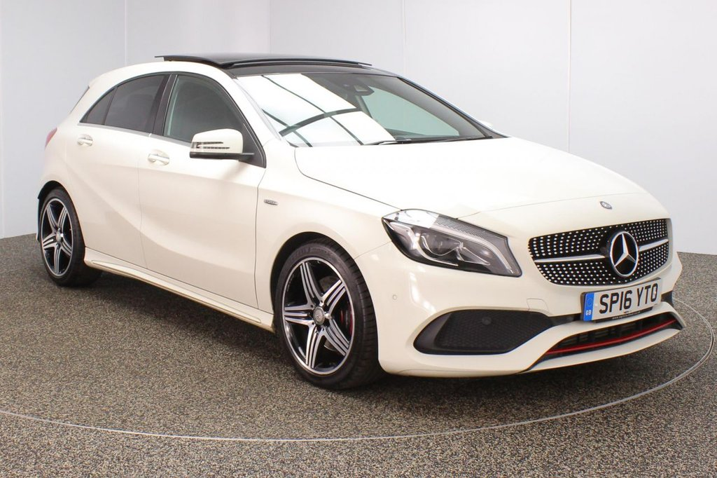 USED 2016 16 MERCEDES-BENZ A-CLASS 2.0 A 250 AMG PREMIUM 5DR 1 OWNER 215 BHP FINISHED IN A STUNNING CALCITE WHITE STYLED WITH 18 INCH ALLOYS AND BLACK HEATED HALF LEATHER SEATS + FULL SERVICE HISTORY + SATELLITE NAVIGATION + PANORAMIC ROOF + REVERSE CAMERA + ELECTRIC MEMORY SEATS + FRONT AND REAR PARKING SENSORS + BLUETOOTH CONNECTIVITY  + HARMAN KARDON SPEAKERS + IN CAR ENTERTAINMENT: CD/ USB + CLIMATE CONTROL + MULTI FUNCTION WHEEL + PRIVACY GLASS + XENON HEADLIGHTS + ELECTRIC WINDOWS + ELECTRIC MIRRORS + STOP/START SYSTEM + ULEZ EXEMPT