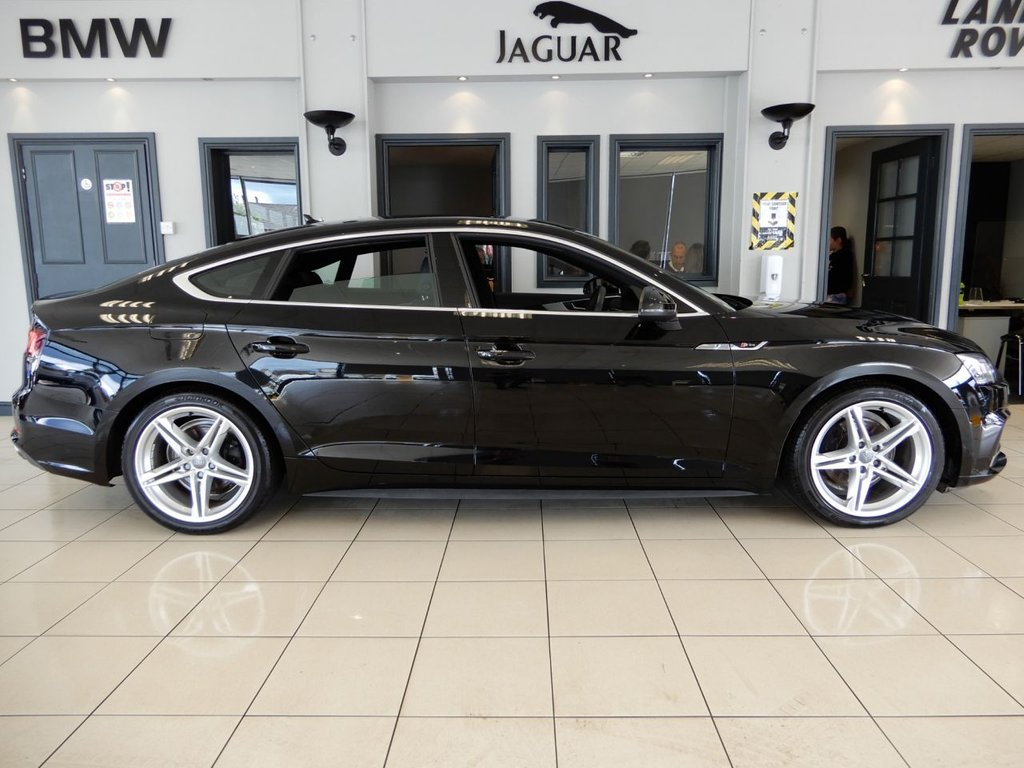 USED 2018 18 AUDI A5 2.0 SPORTBACK TFSI S LINE 5d AUTO 188 BHP FINISHED IN A STUNNING METALLIC BLACK, COMPLIMENTED BY DARK GREY, HALF LEATHER HEATED SEATS + 1 OWNER FROM NEW AND RECENTLY SERVICED + COMES WITH THE BALANCE OF AUDI'S MANUFACTURERS WARRANTY UNTIL MARCH 2021 + SATELLITE NAVIGATION + PARKING SENSORS + BLUETOOTH PHONE CONNECTIVITY AND BLUETOOTH MEDIA + APP CONNECT + WIFI CONNECTIVITY + CRUISE CONTROL + CLIMATE CONTROL + MULTI FUNCTION STEERING WHEEL + XENON HEADLIGHTS + DAB DIGITAL RADIO + ELECTRIC WINDOWS + ELECTRIC/HEATED/FOLDING DOOR MIRRORS +