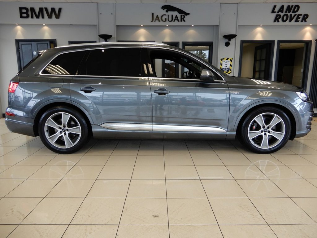 USED 2018 18 AUDI SQ7 4.0 SQ7 TDI QUATTRO 5d AUTO 429 BHP FINISHED IN A STUNNING METALLIC GREY COMPLIMENTED BY BLACK HEATED LEATHER SEATS + 1 OWNER FROM NEW WITH A FULL AUDI MAIN DEALER SERVICE HISTORY + A SIMPLY OUTSTANDING CAR, BEAUTIFULLY CARED FOR AND IN SHOWROOM CONDITION THROUGHOUT + 7 SEATS + VIRTUAL COCKPIT + FULL DIGITAL DASH DISPLAY + SATELLITE NAVIGATION + REVERSE CAMERA + PARKING SENSORS + BLUETOOTH PHONE CONNECTIVITY AND BLUETOOTH MEDIA + CLIMATE CONTROLLED DUAL ZONE AIRCONDITIONING + MULTI FUNCTION STEERING WHEEL + PRIVACY GLASS + XENON H