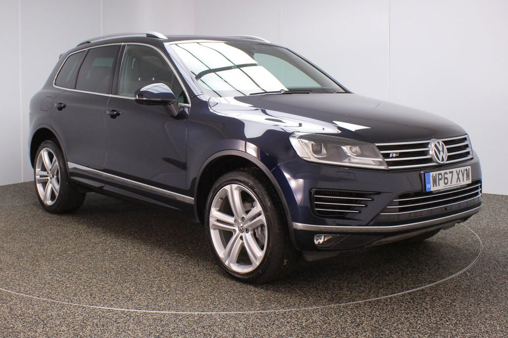 USED 2017 67 VOLKSWAGEN TOUAREG 3.0 V6 R-LINE PLUS TDI BLUEMOTION TECHNOLOGY 5DR 1 OWNER AUTO 259 BHP FINISHED IN A STUNNING BLUE STYLED WITH 21 INCH BLACK ALLOYS ALONG WITH BLACK HEATED FULL LEATHER SEATS + ELECTRIC ADJUSTABLE FRONT SEATS + SERVICE HISTORY + FRONT AND REAR PARKING SENSORS + PANORAMIC ROOF + SATELLITE NAVIGATION + BLUETOOTH CONNECTIVITY + CRUISE CONTROL + CLIMATE CONTROL + MULTI FUNCTION WHEEL + IN CAR ENTERTAINMENT: CD/ IPOD/ USB/ SD + REVERSE CAMERA +  HEATED STEERING WHEEL + XENON HEADLIGHTS + PRIVACY GLASS + ELECTRIC FRONT SEATS + DAB RADIO + ELECTRIC WINDOWS + ELECTRIC BOOT
