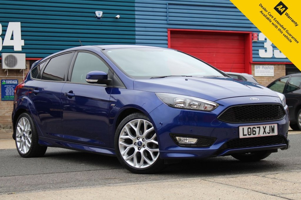 USED 2018 67 FORD FOCUS 1.0 ST-LINE 5d 124 BHP ** BRAND NEW ADVISORY FREE MOT + SERVICE **  UPGRADED SAT NAV +  PARK ASSIST WITH FRONT & REAR PARKING AID ** BLUETOOTH ** AIR CONDITIONING ** UPGRADED ALLOY WHEELS ** ULEZ CHARGE EXEMPT ** LOW RATE £0 DEPOSIT FINANCE FINANCE AVAILABLE ** NATIONWIDE DELIVERY AVAILABLE ** CLICK & COLLECT AVAILABLE **