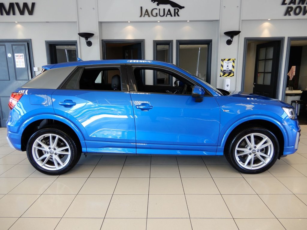 """USED 2018 18 AUDI Q2 1.6 TDI S LINE 5d AUTO 114 BHP FINISHED IN STUNNING METALLIC ARA BLUE WITH CONTRASTING HALF LEATHER HALF CLOTH SEATS + BLUETOOTH MEDIA WITH APP CONNECT AND WIFI CONNECTIVITY + SUPER LOW MILEAGE EXAMPLE AND IN SHOWROOM CONDITION + DUAL ZONE AIR CONDITIONING WITH AUTOMATIC CLIMATE CONTROL + CRUISE CONTROL + AUTOMATIC ADAPTIVE HEADLIGHTS WITH LED DAYTIME RUNNING LIGHTS + AUTOMATIC WIPERS + PARKING SENSORS + PADDLE SHIFT GEARS + SELECTABLE DRIVING MODES + POWER FOLDING HEATED MIRRORS + 18"""" SILVER UNMARKED ALLOY WHEELS + ULEZ COMP"""