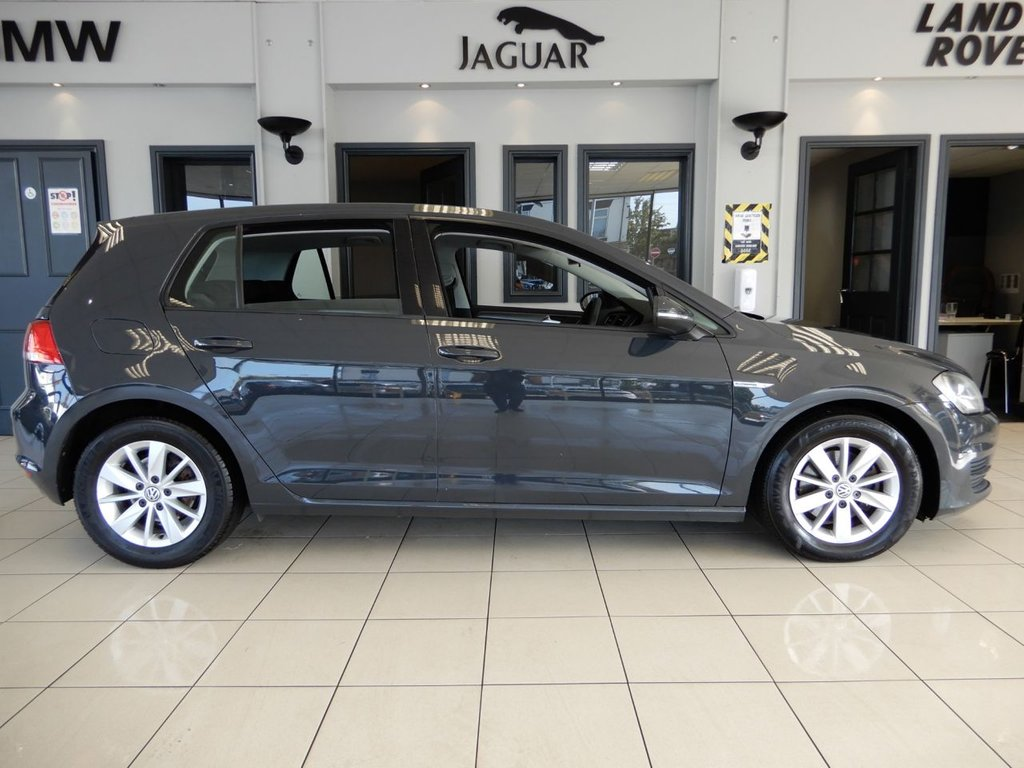 USED 2014 64 VOLKSWAGEN GOLF 1.6 BLUEMOTION TDI 5d 108 BHP FINISHED IN STUNNING METALLIC GREY, COMPLIMENTED BY BLACK AND GREY SEATS + 1 FORMER KEEPER (2 IN TOTAL) + BEAUTIFULLY CARED FOR GOLF COMES WITH AN IMPECCABLE FULL SERVICE HISTORY + BLUETOOTH PHONE CONNECTIVITY AND BLUETOOTH MEDIA + AIR CONDITIONING + DAB DIGITAL RADIO + FRONT AND REAR PARKING SENSORS + ECO STOP/START SYSTEM + AUTOHOLD + ELECTRIC HEATED MIRRORS + ELECTRIC WINDOWS + VW MEDIA INPUT CONNECTION + SPOTLESSLY CLEAN THROUGHOUT