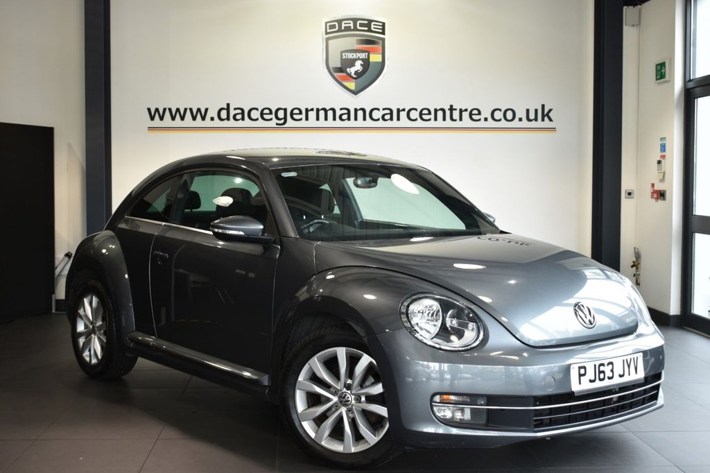 """USED 2013 63 VOLKSWAGEN BEETLE 1.6 DESIGN TDI BLUEMOTION TECHNOLOGY 3DR 104 BHP Finished in a stunning metallic grey styled with 17"""" alloys. Upon opening the drivers door you are presented with cloth upholstery, full service history, dab radio, multi functional steering wheel, heated mirrors, auto stop/start function, air conditioning"""