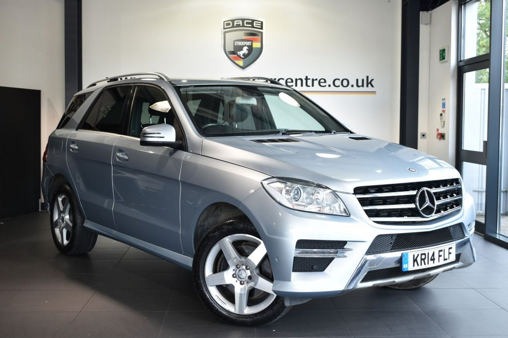 USED 2014 14 MERCEDES-BENZ M-CLASS 3.0 ML350 BLUETEC AMG SPORT 5DR AUTO 258 BHP Finished in a stunning metallic silver styled with alloys. Upon opening the drivers door you are presented with half leather interior, full service history, satellite navigation, bluetooth, cruise control, multi functional steering wheel, easy pack powered tailgate, electric folding mirrors, active park assist