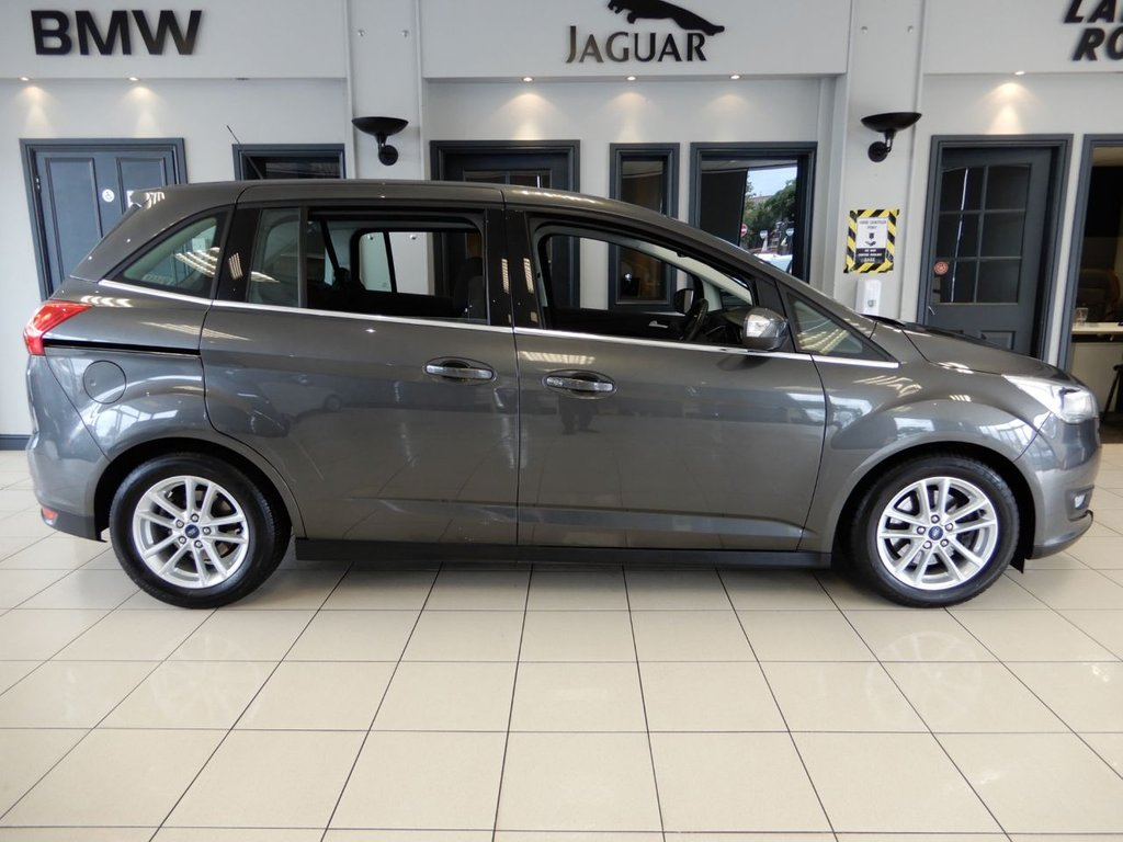 USED 2017 67 FORD GRAND C-MAX 1.5 ZETEC TDCI 5d 118 BHP FINISHED IN STUNNING METALLIC GREY WITH CONTRASTING FULL BLACK CLOTH SEATS + 1 FORMER KEEPER + TOUCH SCREEN SATELLITE NAVIGATION + DAB DIGTAL RADIO + BLUETOOTH MEDIA + LOW MILEAGE GEM + SPOTLESSLY CLEAN INSIDE AND OUT + DUAL ZONE AIR CONDITONING + FULLY FOLABLE REAR SEATS + CRUISE CONTROL + AUTOMATIC LIGHTS WITH LED DAYTIME RUNNING LIGHTS + HEATED MIRRORS + POWER FOLDING MIRRORS + 17