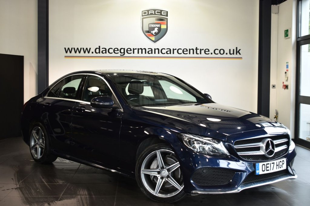 """USED 2017 17 MERCEDES-BENZ C-CLASS 2.1 C 220 D AMG LINE 4DR AUTO 170 BHP Finished in a stunning cavansite metallic blue styled with  18"""" alloys. Upon opening the drivers door you are presented with full leather interior, full service history, satellite navigation, bluetooth, heated seats, reversing camera, cruise control, dab radio, touchpad with rotary pushbutton, rain sensors, electric folding mirrors, ambient lighting, AMG styling package, active park assist"""