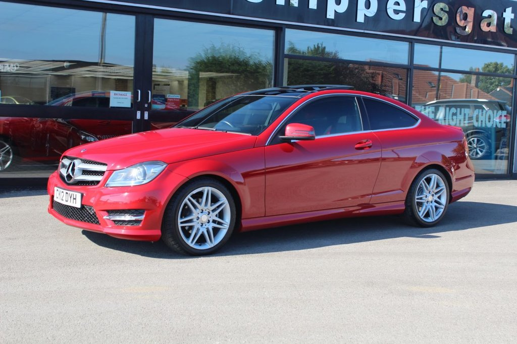 USED 2012 12 MERCEDES-BENZ C-CLASS 2.1 C220 CDI BLUEEFFICIENCY AMG SPORT PLUS 2d 168 BHP Fire Opal Red, Panoramic Sliding Glass Sunroof, Parking Guidance, LED Daytime Running Lights, Auto Di Mirrors, Rain Sensor, Multi Function Steering Wheel, Cruise Control, Rain Sensor, Tyre Pressure Loss Warner, Electric Folding Mirrors, Navibox Preinstulation, DAB Radio, Privacy Glass, AMG Alloys, AMG Styling Package, AMG Sports Package Plus, 2 Keys and Book Pack, Full Service History.