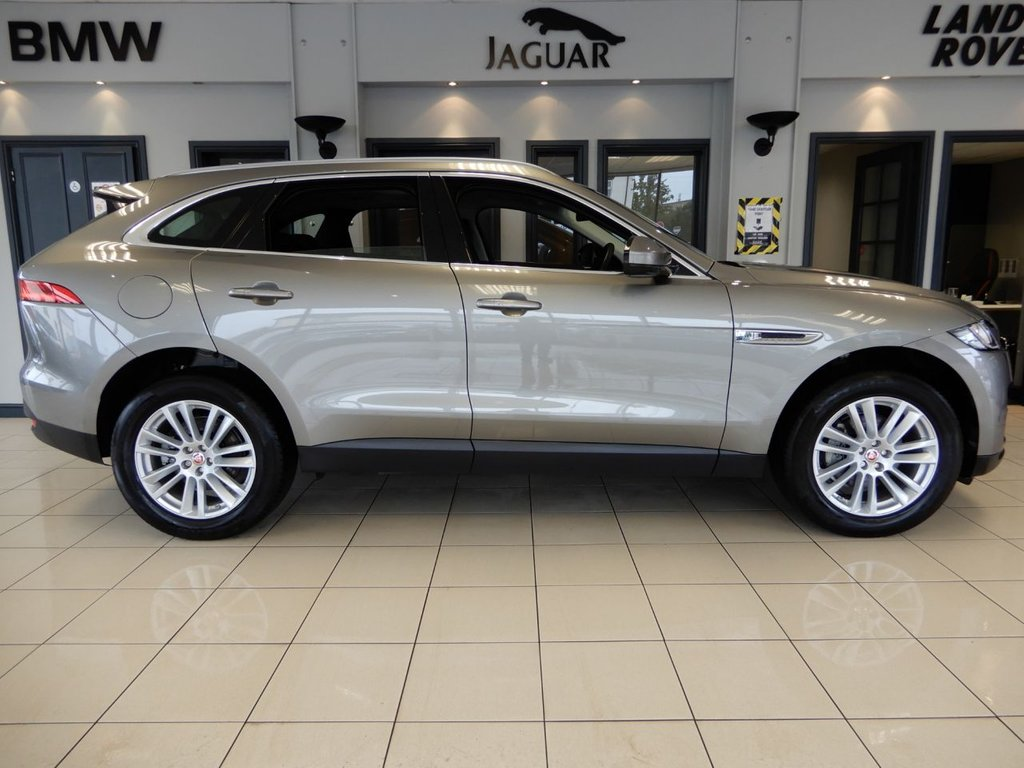USED 2017 17 JAGUAR F-PACE 2.0 PORTFOLIO AWD 5d 178 BHP FINISHED IN STUNNING METALLIC CHAMPAGNE SILVER COMPLIMENTED BY FULL BLACK LEATHER HEATED MEMORY PROGRAMMABLE ELECTRIC SEATS + BEAUTIFUL LOW MILEAGE, HIGH SPECIFICATION F PACE  + PANORAMIC GLASS ROOF + TOUCH SCREEN SATELLITE NAVIGATION AND MEDIA DISPLAY WITH MERIDIAN SPEAKER SYSTEM + HEATED SEATS + COMFORT ACCESS + REAR VIEW CAMERA + LANE ASSISTANCE + DARK WOOD VENEER INTERIOR TRIM + HEATED FRONT SCREEN + 2 KEYS + JAGUAR SERVICE HISTORY + FRONT AND REAR PARK ASSIST + WIFI HOTSPOT