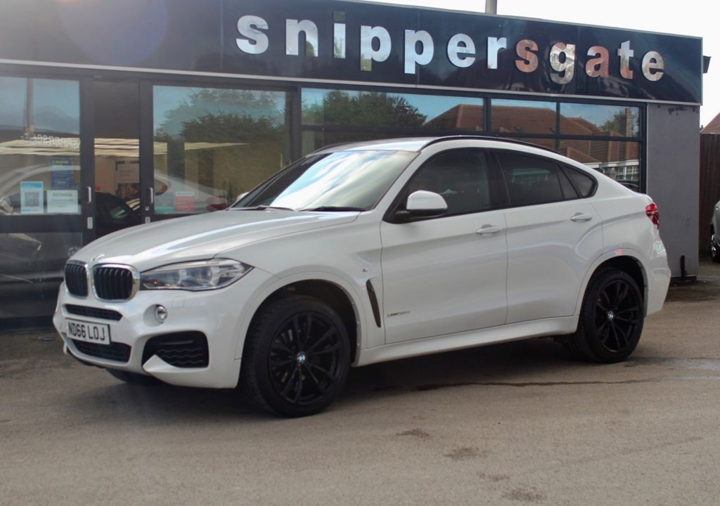 "USED 2016 66 BMW X6 3.0 XDRIVE30D M SPORT 4d 255 BHP Mineral White Metallic, 1 Owner, 20"" Double Spoke Alloys, Sun Protection Navigation System Professional, DAB TunerGlass, Electric Seats With Memory, Sports Seats, Heated Seats, Park Distance Control, Light Package, LED Fog Lights, Tyre Pressure Display, Auto Dimming Mirrors, Adaptive M Chassis, M Sport Package, Black Roof Rails, Storage Compartment package, M Leather Steering Wheel, 2 Keys and Book Pack, Full BMW Service History."