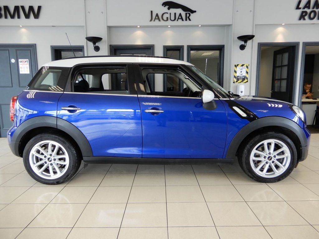 USED 2015 65 MINI COUNTRYMAN 1.6 COOPER D 5d 112 BHP FINISHED IN STUNNING METALLIC BLUE WITH BEAUTIFULLY CONTRASTING WHITE ROOF, MIRROR CAPS AND BONNET STRIPES + HALF LEATHER SEATS + WONDERFUL SPECIFICATION WITH CHILI AND MEDIA PACKS + 1 OWNER FROM NEW WITH A FULL BMW MINI MAIN DEALER SERVICE HISTORY + SATELLITE NAVIGATION + DAB DIGITAL RADIO + BLUETOOTH MEDIA + CLIMATE CONTROL + DUAL ZONE AIR CONDITIONING + VOICE COMMAND + AUTOMATIC LIGHTS + AUTOMATIC WIPERS + SELECTABLE DRIVING MODES + FULL MAIN DEALER HISTORY + ISOFIX POINTS + 60/40 FOLDING REA