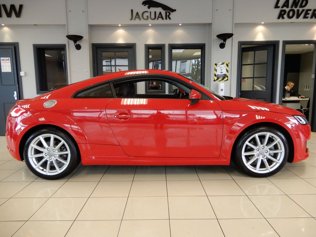 USED 2017 66 AUDI TT 2.0 TFSI QUATTRO SPORT 2d AUTO 227 BHP FINISHED IN STUNNING METALLIC TANGO RED AND COMPLIMENTED BY DARK LEATHER/ALCANTARA SEATS + VIRTUAL COCKPIT + AN EXCEPTIONAL, LOW MILEAGE EXAMPLE + 1 OWNER FROM NEW AND COMES WITH A COMPREHENSIVE AUDI MAIN DEALER SERVICE HISTORY + DAB DIGITAL RADIO + PADDLE GEAR SELECT + SELECTABLE DRIVING MODES + VOICE COMMAND + BLUETOOTH PHONE CONNECTIVITY AND BLUETOOTH MEDIA + RAIN SENSORS + MATRIX BEAM LED LIGHTS + AUDI PARK AND SOUND SYSTEM + ELECTRIC LUMBAR SUPPORT + HILL HOLD ASSIST