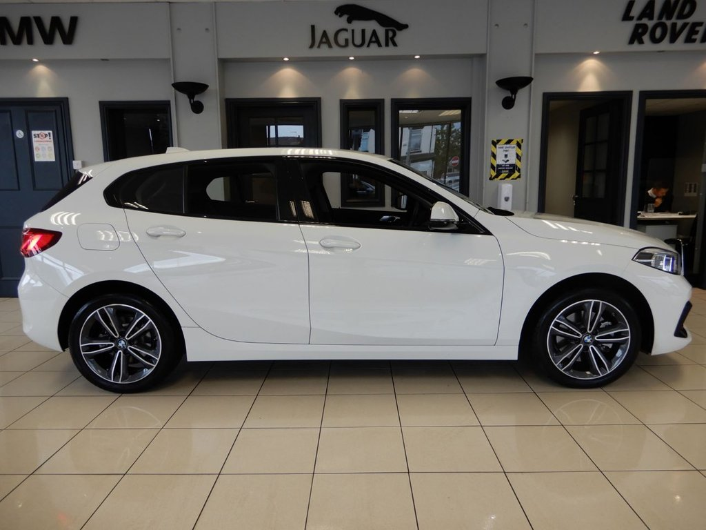 USED 2020 69 BMW 1 SERIES 1.5 116D SPORT 5d 115 BHP FINISHED IN STUNNING WHITE WITH CONTRASTING DARK GREY 7 ORANGE HALF LEATHER SEATS + ABSOLUTELY IMMACULATE, 1 OWNER, LOW MILEAGE GEM + NEW SHAPE + SATELLITE NAVIGATION + ELECTRIC LUMBAR SUPPORT + SELECTABLE DRIVING MODES + XENON HEADLIGHTS + BLUETOOTH PHONE AND BLUETOOTH MEDIA + IN CAR ENTERTAINMENT AUX/USB + DUAL ZONE AIR CONDITIONING + CLIMATE CONTROL + MULTIFUNCTIONAL STEERING WHEEL + ECO STOP/START FUNCTION + AUTOMATIC LIGHTS + DIGITAL DASH + RAIN SENSORS + LIGHT PACKAGE + CRUISE CONTROL