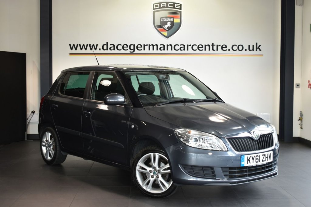 """USED 2011 61 SKODA FABIA 1.2 SE PLUS 5DR 68 BHP Finished in a stunning metallic grey styled with 16"""" alloys. Upon opening the drivers door you are presented with cloth upholstery, full service history, cruise control, auxiliary port, multi functional steering wheel, air conditioning, heated rear window, heated mirrors"""