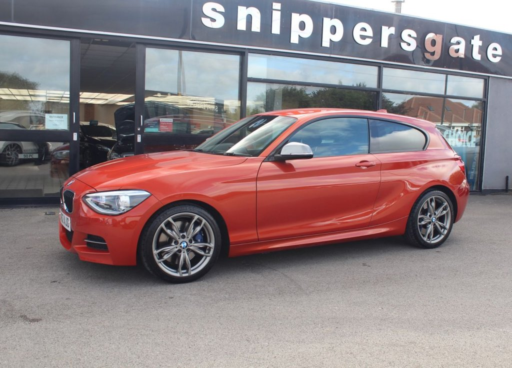 USED 2012 62 BMW 1 SERIES 3.0 M135I 3d 316 BHP Big SpecificationValencia Orange Metallic M135I, Adaptive M Suspension, Harman Kardon Music System, Professional Navigation, Adaptive Headlights, Heated Black Leather Seats, Electric Folding Mirrors, Front and Rear Parking Sensors, Bluetooth Phone, 2 Keys and Book Pack, Service History- Recent 8 Year Major Service at BMW.