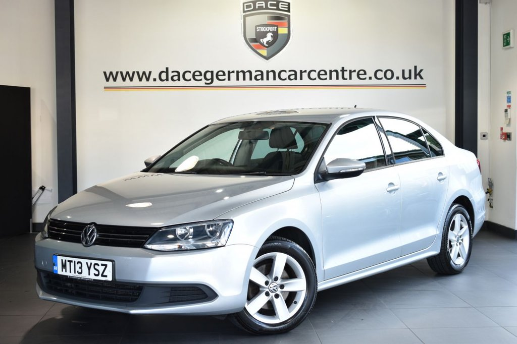 "USED 2013 13 VOLKSWAGEN JETTA 1.6 SE TDI BLUEMOTION TECHNOLOGY 4DR 104 BHP Finished in a stunning reflex metallic silver styled with 16"" alloys. Upon opening the drivers door you are presented with cloth upholstery, full service history, bluetooth, cruise control, dab radio, multi functional steering wheel, heated mirrors, air conditioning, auxiliary port"