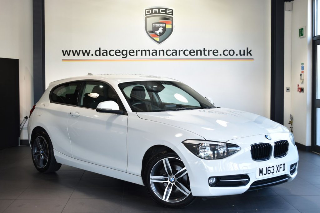USED 2013 63 BMW 1 SERIES 1.6 116I SPORT 3DR 135 BHP Finished in a stunning alpine white styled with alloys. Upon opening the drivers door you are presented with cloth upholstery, superb service history, bluetooth, dab radio, sport seats, Multifunction steering wheel, Rain sensors, privacy glass