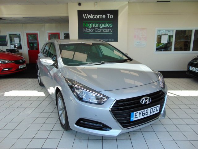 """USED 2016 66 HYUNDAI I40 1.7 CRDI SE NAV BLUE DRIVE 5d 114 BHP THIS HYUNDAI I40 1.7 CRDI SE NAV ESTATE CAR COMES WITH SERVICE HISTORY + SEPTEMBER 2021 MOT + SATELLITE NAVIGATION + CLIMATE CONTROL + CRUISE CONTROL + REVERSING SENSORS +  SPARE WHEEL + DAB RADIO + PRIVACY GLASS + REMOTE CENTRAL LOCKING + ELECTRIC WINDOWS + ONLY £20 ROAD TAX + AUTO LIGHTS + AUTO WIPERS + FRONT LED FOG LIGHTS + ALARM + DAYTIME RUNNING LIGHTS + ISOFIX + 16"""" ALLOY WHEELS + DRIVERS ELECTRIC SEAT HEIGHT ADJUSTMENT + SPLIT FOLDING REAR SEATS + HEATED FRONT SEATS + AND MUCH MORE"""