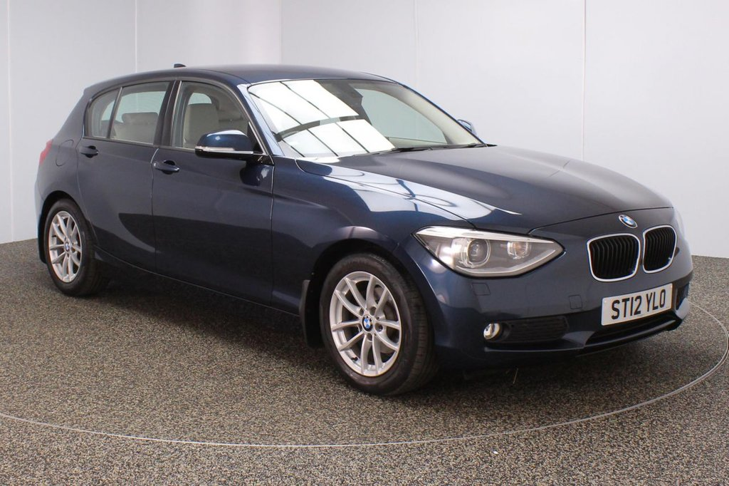 USED 2012 12 BMW 1 SERIES 2.0 118D SE 5DR 141 BHP FULL SERVICE HISTORY + £30 12 MONTHS ROAD TAX + DAKOTA LEATHER SEATS + PARKING SENSOR + BLUETOOTH + CLIMATE CONTROL + MULTI FUNCTION WHEEL + XENON HEADLIGHTS + RADIO/CD + AUX/USB PORTS + ELECTRIC WINDOWS + ELECTRIC MIRRORS + 16 INCH ALLOY WHEELS