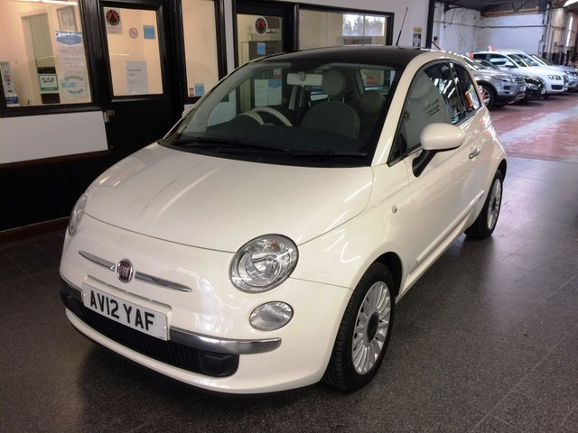 "USED 2012 12 FIAT 500 1.2 LOUNGE 3d 69 BHP This £30 Tax 500 is finished in Bossanova White with White & Black cloth seats. It is fitted with power steering, remote locking, electric windows and mirrors, climate control, fixed panoramic sunroof, Blue & Me, 16"" Alloy wheels, CD Stereo with USB port and more. We will include a new mot, a service and 6 months RAC insured warranty. Finance and extended warranties are available. It has had two owners, the supplying dealer for a few months and one lady."