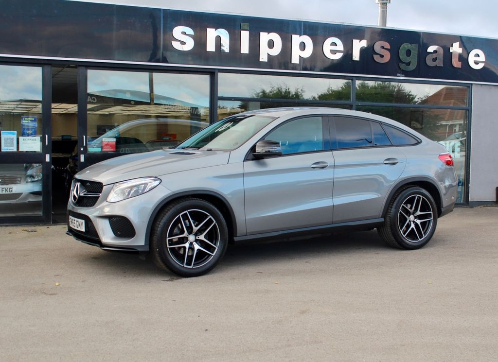 """USED 2015 65 MERCEDES-BENZ GLE-CLASS 3.0 GLE 350 D 4MATIC AMG LINE 4d 255 BHP Palladium Silver Metallic, Full Black Leather, Night PackRear View Camera, 21"""" AMG Double Spoke Alloys, Adaptive Damping System, Keyless Start, Heated Seats, Active Park Assist, Sorts Seats, Auto Dim Mirrors, Dynamic LED Headlights, Electric Folding Mirrors, Sports Steering Wheel, Tyre Pressure Control, 9 Speed Automatic, Traffic Sign Recognition, Privacy Glass, Command, DAB Radio, Logo Projection From Mirrors, Automatic High Beam Switch Plus, Aluminium Trim Pieces, AMG Styling Package, Mirrors"""