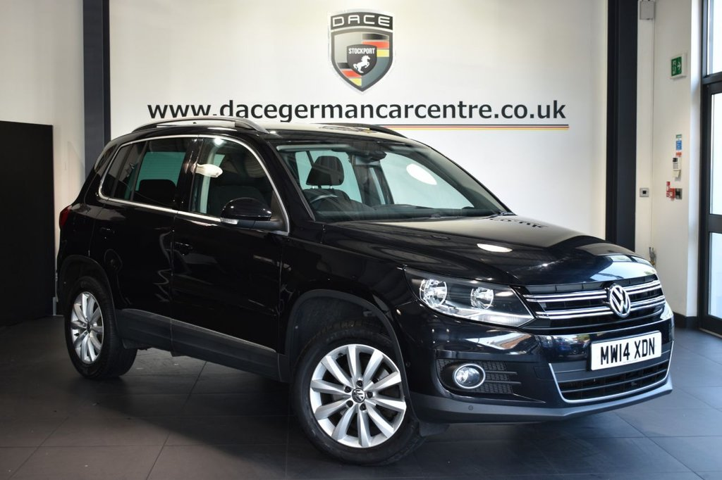 """USED 2014 14 VOLKSWAGEN TIGUAN 2.0 MATCH TDI BLUEMOTION TECH NAV 4MOTION DSG 5d AUTO 139 BHP Finished in a stunning black styled with 17"""" alloys. Upon opening the drivers door you are presented with cloth upholstery, full service history, satellite navigation, bluetooth, dab radio, multi functional steering wheel, heated mirrors, parking sensors"""