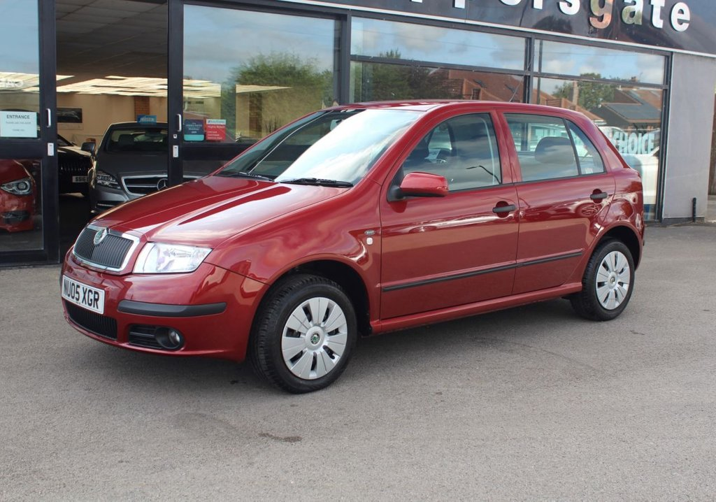 USED 2005 05 SKODA FABIA 1.4 AMBIENTE 16V 75 5d 74 BHP Rare opportunity to purchase an incredibly low mileage Skoda Fabia in fantastic Condition, Flamenco Red Metallic, Parking Sensors, Power Steering, Remote Central Locking, Electric Windows, Electric Adjustable and Heated Door Mirrors,  Radio/CD System, 2 Keys and Book Pack, 7 services carried out (6 Skoda main Dealer Services).