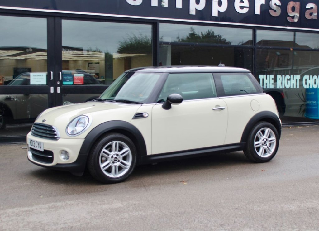 """USED 2013 13 MINI HATCH COOPER 1.6 COOPER 3d 122 BHP Pepper White Mini Cooper With Chilli Pack (£2315 Option), Piano Black Interior Trim (£130 Option), Chrome Line Interior (£110 Option), Colour Line - Carbon Black (£110 Option), Roof and Mirror Caps in Black, Half Leather Interior, Remote Central Locking, Automatic Air Conditioning, 17"""" Alloys, Onboard Computer, Leather Trimmed Multi Function Steering Wheel, Rain Sensing Wipers, 2 Keys and Book Pack, Full Service History."""