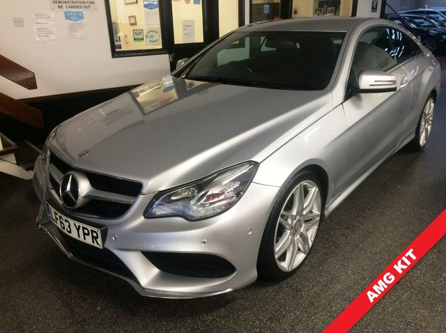 "USED 2013 63 MERCEDES-BENZ E-CLASS 2.1 E220 CDI AMG SPORT 2d 170 BHP This Mercedes E-Class Coupe has just had wheels refurbished is finished in Metallic Silver with Black full leather heated partially electric seats. It is fitted with power steering, remote locking, electric windows mirrors with power fold and part front seats, climate control, cruise control, Satellite Navigation, Bluetooth, front and rear parking sensors, AMG 19"" alloy wheels, CD Stereo with Aux port and more. It has been privately owned from new and comes with a full service history."