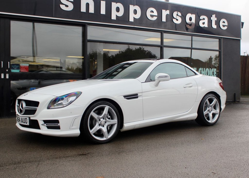 USED 2015 64 MERCEDES-BENZ SLK 2.1 SLK250 CDI BLUEEFFICIENCY AMG SPORT 2d 204 BHP Huge Specification Polar White SLK AMG Sport, Satellite Navigation, Parktronic - Front and Rear Parking Sensors, Panoramic Glass Sunroof, Heated Seats, Mirror Package - Folding Mirrors, Airscarf Neck Level Heater, Bluetooth Phone, LED Daytime Running Lights, Cup Holder, Steering Wheel Gear Shift Paddles, Tyre Pressure Control, CD Changer, Universa Communications Interface, DAB Radio, AMG Styling Package, AMG Sports Package, Aluminium Interior Trim, Service History.