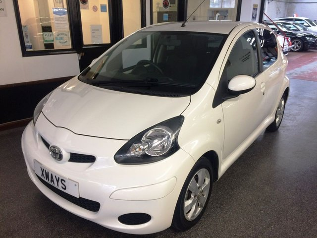 USED 2010 60 TOYOTA AYGO 1.0 VVT-I GO 5d 67 BHP This £20 Tax 5 door AYGO is finished in Cirrus White with Black cloth seats. It is fitted with power steering, remote locking, electric windows, steel spare wheel, air conditioning,  CD Stereo with USB & Aux port and more. It has been owned by The supplying Toyota dealer one private lady from new (acquired it in 2012) and comes with a full Toyota and independent garage service history consisting of 7 stamps. We will supply this with 12 months MOT, a service and 6 months RAC warranty