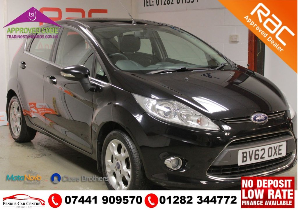 "USED 2012 62 FORD FIESTA 1.2 ZETEC 5d 81 BHP NEW MOT + RAC PLATINUM WARRANTY + Low Mileage + 2 Owners  + 2 Keys + 15"" Alloys + Premium Sound System With USB AUX PORT Input + Isofix Child Seat Locking System + Bluetooth + Front Fog Lights"