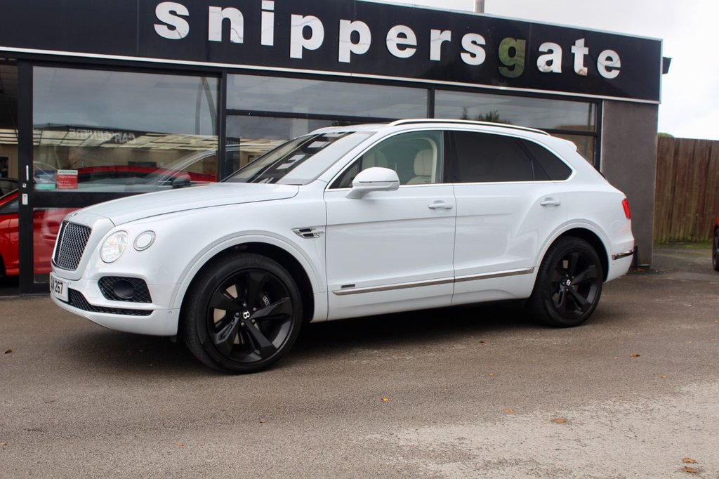 "USED 2017 BENTLEY BENTAYGA 4.0 V8 D 5d 430 BHP Pearlescent Ice White, Full Bentley Service History, NAIM Sound System, Bentley Dynamic Ride, City Specification Pack, Touring Specification Pack, Panoramic Sunroof, Front Seat Comfort Specification, 22"" Alloys, Privacy Glass,Full Bentley Service History."