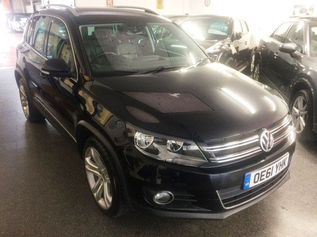 USED 2012 61 VOLKSWAGEN TIGUAN 2.0 SPORT TDI BLUEMOTION TECHNOLOGY 4MOTION DSG 5d 138 BHP New cambelt fitted in 2018 @ 60959 miles. This 4WD Tiguan is finished in Black with Black heated leather electric seats. It is fitted with power steering, remote locking, electric windows and mirrors, air conditioning, auto day lights, VW Sat Navigation, Bluetooth, start stop, hill assist,  alloy wheels with space saver wheel, CD Stereo with Aux port and more. It has had three owners from new and comes with a full service history consisting of stamps and invoices.