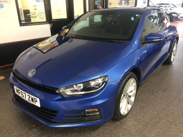"""USED 2017 67 VOLKSWAGEN SCIROCCO 2.0 GT TSI BLUEMOTION TECHNOLOGY 2d 178 BHP One of the last of these produced!! This one owner from new Scirocco GT TECH TSi is finished in signature Rising Blue metallic with grey suede/cloth & leather seats. It is fitted with power steering, remote locking, electric windows and mirrors, dual zone climate control, front and rear parking sensors, Apple car play and mirror link, VW Sat Nav, Bluetooth, DAB CD Stereo with media connections, 18"""" 10 spoke alloy wheels and more. It has had owner, Volkswagen management services."""