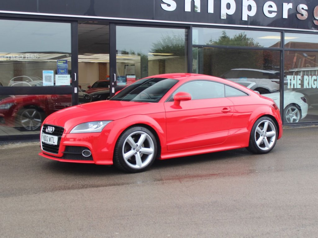 "USED 2012 12 AUDI TT 1.8 TFSI S LINE 2d  Fantastic Condition Red Audi TT,  1 Previous Owner, Bluetooth Phone , 18"" Alloy Wheels, Remote Central Locking, Electric Heated Mirrors, Electronic Climate Control, Thatcham CAT1 Alarm/Immobiliser, 3 Spoke Flat Bottomed Multi Function Sports Steering Wheel, 2 Keys and Book Pack, Full Service History."