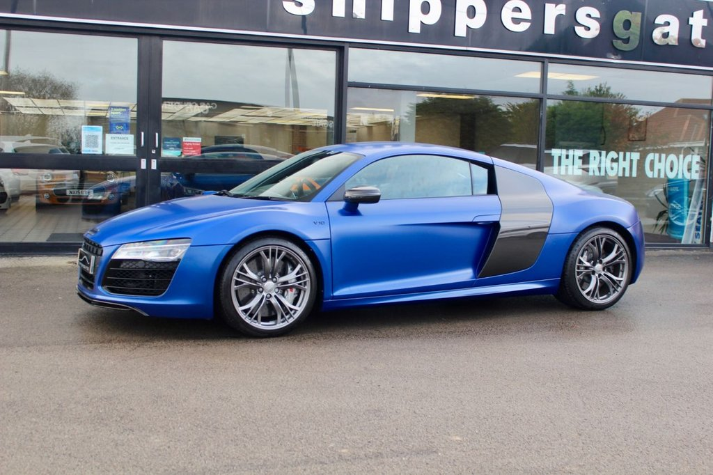 USED 2014 14 AUDI R8 5.2 V10 PLUS S Tronic Quattro 542 BHP 2dr Ceramic Brakes, Heated Electric Bucket Seats, Satellite Navigation SystemCarbon Fibre Interior Trim, Carbon Sigma Sideblades, Audi Music Interface, Coloured Stitching For Fine Nappa Leather, Bluetooth Phone Connection, Cornering Lights, Kerb Illumination, Dual ClutchGearbox, Electric Foldable Mirrors, Headlight Cleaners, Hill Hold, Heated Washers, Light Sensitive Rear View Mirror, Low Tyre Pressure Indicator, 2 Keys and Book Pack, Full Audi Service History.