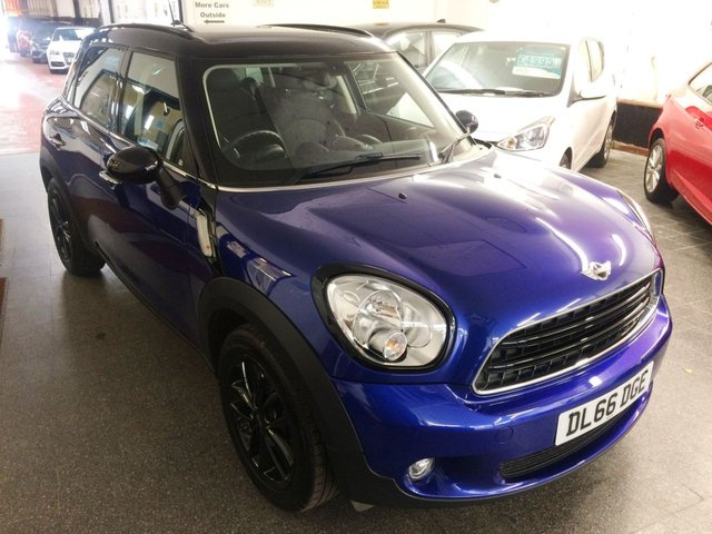 "USED 2016 66 MINI COUNTRYMAN 1.6 COOPER D 5d 112 BHP This £20 tax Mini Countryman is finished in Metallic Starlight Blue with black pack (mirrors and roof) along with black cloth & Leather seats. It is fitted with Chilli pack including remote locking (2 keys), electric windows and mirrors, climate controlled air conditioning,  DAB Bluetooth, 17"" Black alloy wheels, sport multi function steering wheel including cruise control, LED Daylights, privacy glass,auto lights, white indicators, rear park assist, mood lighting and more."
