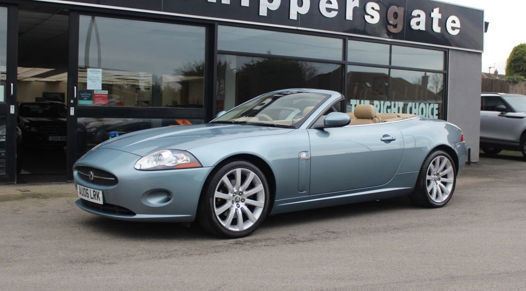 USED 2006 06 JAGUAR XK 4.2 CONVERTIBLE 2d 294 BHP Zircon Blue Metallic, Caramel Luxury Leather Spot Interior, Burr Walnut Finish, Front and Rear Parking Sensors, Active Front Lighting, Jaguar Premium Surround Sound, Brembo Brakes, Bluetooth Phone, Electric Seats, Remote Opening/Closing Roof, 6 CD Auto Changer, 2 Keys and Book Pack, Full Service History