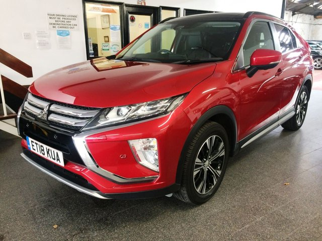 USED 2018 18 MITSUBISHI ECLIPSE CROSS 1.5 4 5d 161 BHP Complete with a retractable Panoramic roof and 360 Rear camera with park assist front and rear, this Eclipse Cross All wheel drive petrol fully Automatic with paddle shift is finished in Premium Red Diamond metallic with black electric heated leather seats. It has smart phone incorporated Apple/Android car play with speaker upgrade, 2 keys with keyless start/ central locking, power steering, electric windows and mirrors with power fold, climate controlled air conditioning, cruise control & more