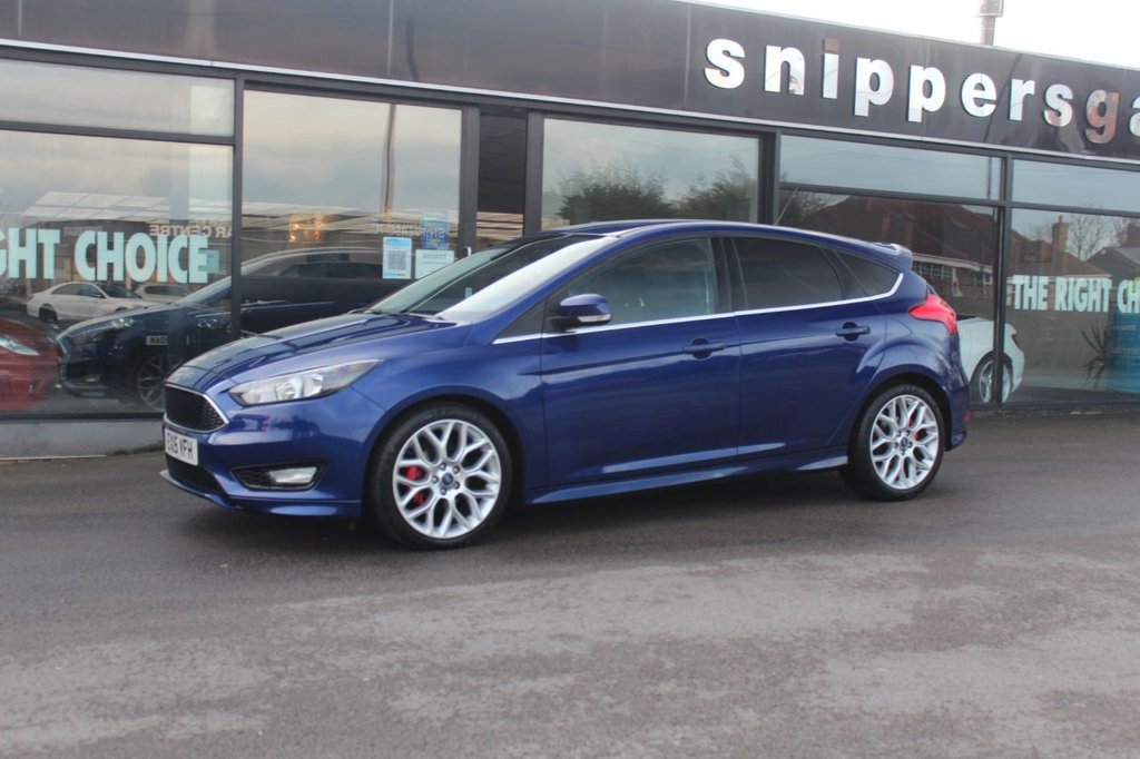 USED 2015 15 FORD FOCUS 1.0 ZETEC S 5d 124 BHP Deep Impact Blue Metallic, Bluetooth, Privacy Glass, Heated Front Windscreen, DAB Radio, Air Conditioning, Remote Central Double Locking, USB Connection, Alloy Wheels, Front Fog Lights, Sports Style Front Seats, Keyless Start, 2 Keys and Book Pack, Full Service History.